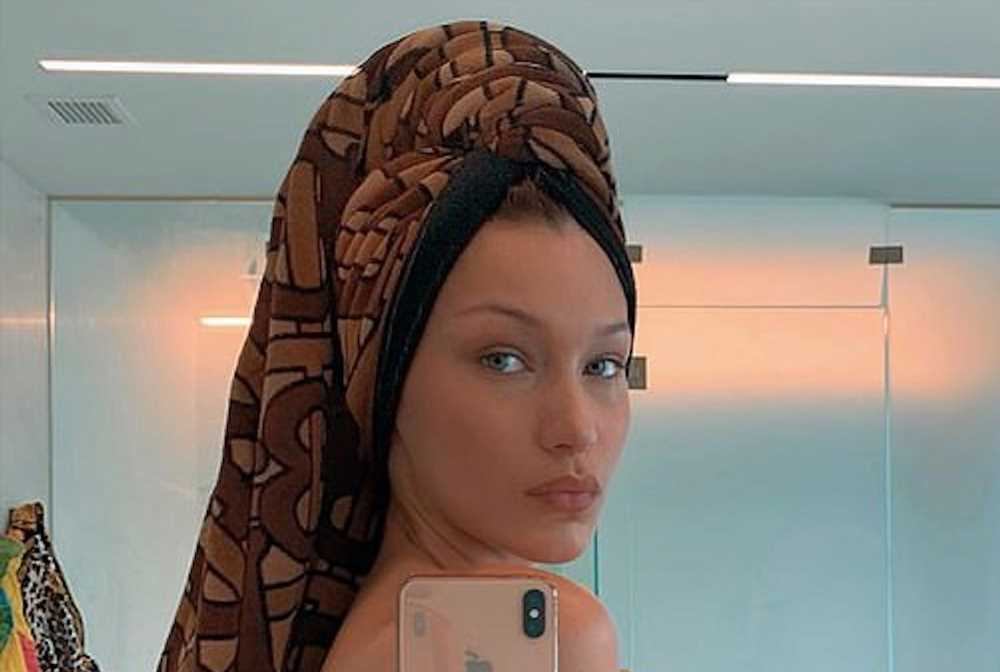 Bella Hadid goes topless in a thong and $620 towel