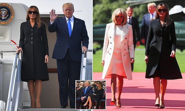 Melania Trump looks sombre in a black coat as she arrives in Normandy