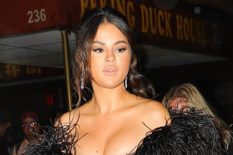 Selena Gomez risks major over-exposure in dress held up by luck alone