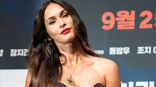 Megan Fox Stuns in Strapless, Plunging Corset Top While Promoting New Film