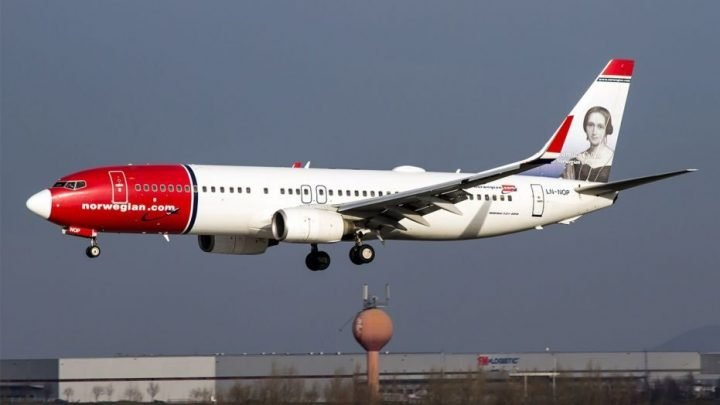 Shards from Norwegian Air flight fall 'like bullets' on neighborhood in Italy, damaging cars, rooftops