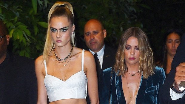 Ashley Benson Wears A Blazer & Short Skirt While Holding Hands With Cara Delevingne At NYFW