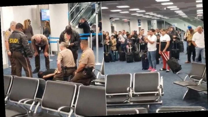Man forces past American Airlines gate at Miami airport, 'ran into the plane screaming,' witness says