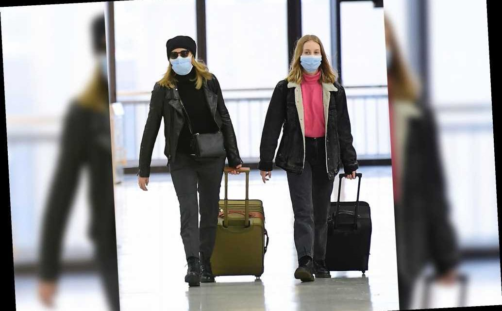 Felicity Huffman and daughter Sophia Macy attempt to go incognito at JFK