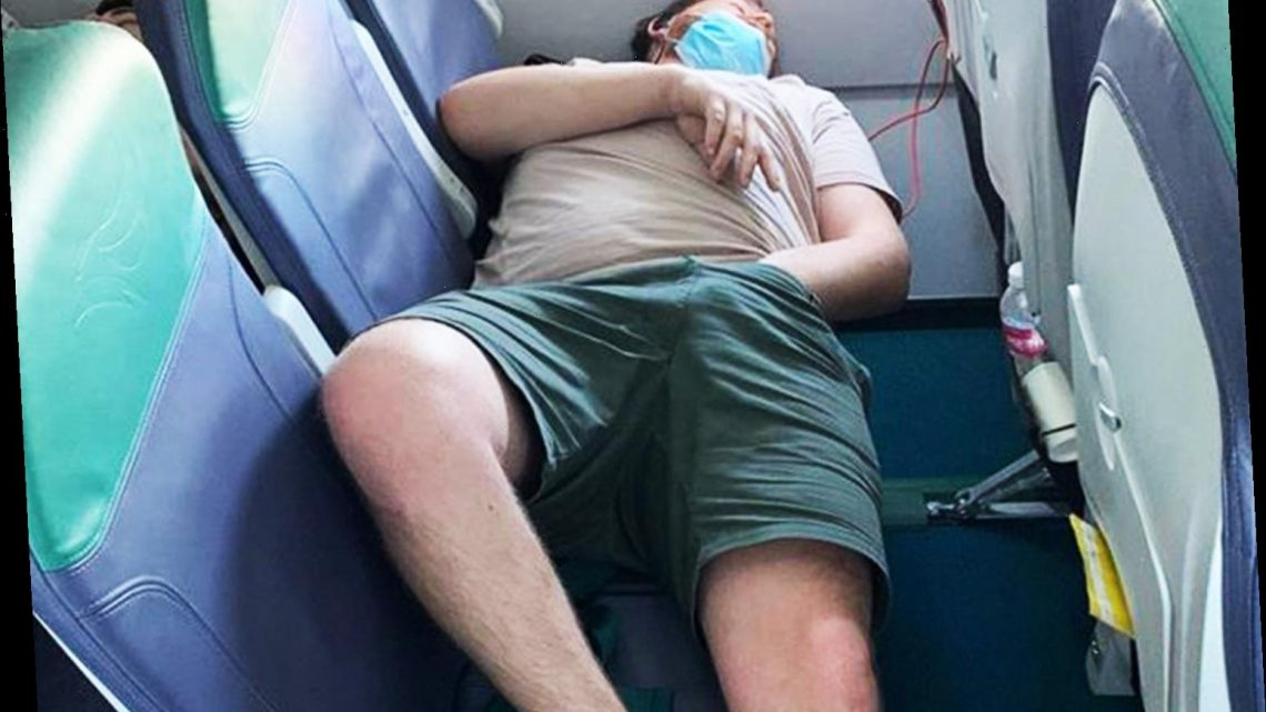 Plane passenger shamed for resting feet on seat, putting hand down shorts AND not wearing his coronavirus mask correctly – The Sun