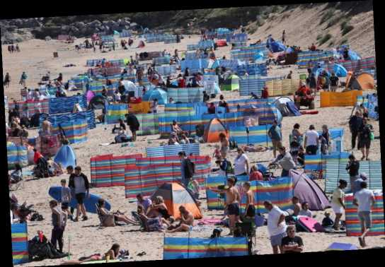Tourists flood Cornwall's beaches and seaside towns, infuriating locals who say visitors aren't social distancing