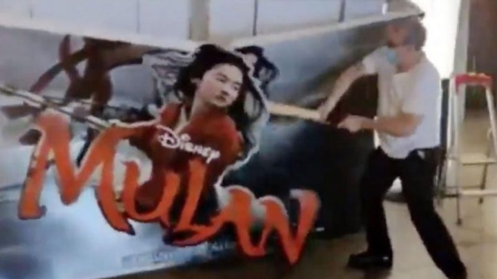 French cinema owner smashes Mulan pop-up poster after Disney decides not to screen it in cinemas