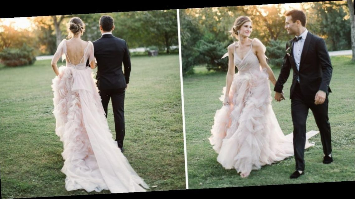A bride tried on 8 gowns before finding a backless, blush wedding dress that fit her like a glove