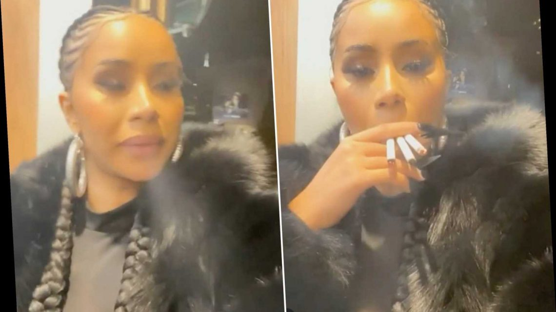 Cardi B smokes three cigarettes at once while watching 'states turn red'