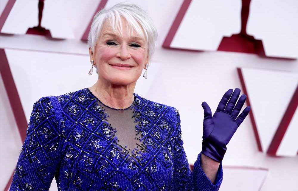 Glenn Close wears a tunic, trousers and gloves at the 2021 Oscars