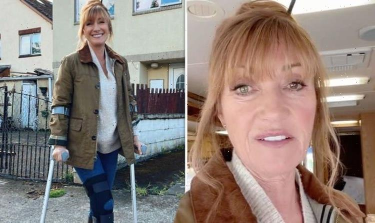 Jane Seymour poses with crutches and leg brace after fall on set 'Trying not to wobble'