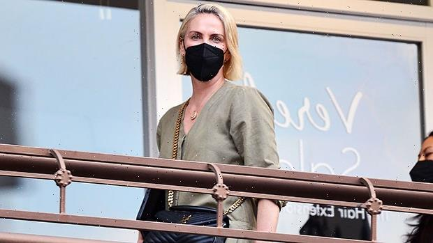 Charlize Theron Glows In A Green Jumpsuit On Rare Outing With Daughters Jackson, 9 & August, 5 — See Pics