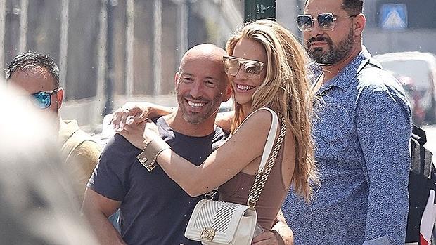 Chrishell Stause & Jason Oppenheim Share A Sweet Hug On Rome Getaway After Confirming Romance