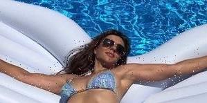 Elizabeth Hurley, 56, Has 'Heavenly' Abs Posing On An Angel Wing Pool Float In New Bikini Instagram Photo