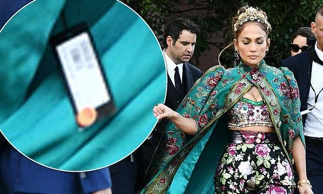 Jennifer Lopez leaves the price tag on her Dolce & Gabbana cape