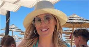 Kate Ferdinand stuns in a blue bikini as she shares throwback holiday snaps with son Cree and husband Rio