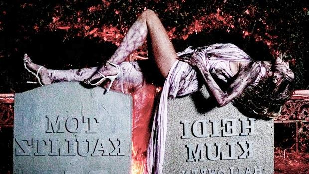 Heidi Klum Lays Across Her Tombstone Covered In Blood & Bandages For Halloween Surprise
